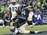 NFL Playoffs 2014: Jan 11, 2014 - Saints vs Seahawks - Marshawn Lynch Photographic Print by Elaine Thompson