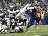 NFL Playoffs 2014: Jan 11, 2014 - Saints vs Seahawks - Marshawn Lynch Photo av Elaine Thompson
