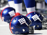 New York Giants Helmets Photographic Print by Bob Leverone