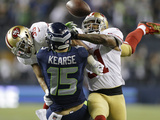 NFL Playoffs 2014: Jan 19, 2014 - 49ers vs Seahawks - Donte Whitner, Eric Reid Photographic Print by Marcio Jose Sanchez