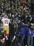 NFL Playoffs 2014: Jan 19, 2014 - 49ers vs Seahawks - Richard Sherman Fotografisk trykk av Marcio Jose Sanchez