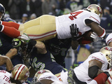 NFL Playoffs 2014: Jan 19, 2014 - 49ers vs Seahawks - Anthony Dixon Photographic Print by Marcio Jose Sanchez