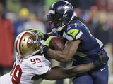 NFL Playoffs 2014: Jan 19, 2014 - 49ers vs Seahawks - Marshawn Lynch Photographic Print by Elaine Thompson