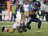 NFL Playoffs 2014: Jan 19, 2014 - 49ers vs Seahawks - Marshawn Lynch Posters av Ted S. Warren