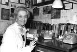Rita Levi-Montalcini Sitting at a Desk Photographic Print