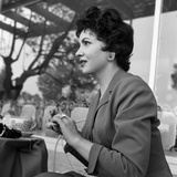 Gina Lollobrigida at the Table of a Bar Photographic Print