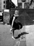 Gio Petré Taking Off One of Her Shoes Photographic Print