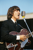 George Harrison Playing Guitar and Singing Photographic Print