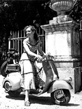Odile Versois on a Vespa Scooter Photographic Print