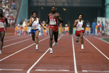 Carl Lewis Running in a Race at the Los Angeles Olympics Photographic Print