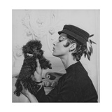 A Model Wearing a Hat Trimmed with Feathers Photographic Print
