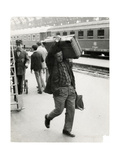 A Man Carrying a Luggage on a Platform of the Central Station Photographic Print
