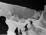 Alpinists Walking in the Snow Photographic Print