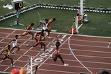 Carl Lewis Crosses the Finishing Line at the Los Angeles Olympics Photographic Print