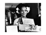 Diana Ross Shows the Statue of 'The Golden Lion' (Il Leone D'oro) at the Venice Film Festival Photographic Print