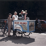 An Ice Cream Man Giving a Cone To a Child Photographic Print
