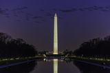 The Washington Monument Seen in the Reflecting Pool at Dusk with a Flock of Geese Photographic Print by Jonathan Irish