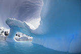 A Blue Iceberg with an Arch Melted into It Photographic Print by Ira Meyer
