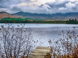 Heavy Clouds over Lake-Side Forested Mountains in Colorful Autumn Hues Photographic Print by Babak Tafreshi
