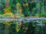 Boulders and Colorful Reflections of Trees in Calm Lake Water Photographic Print by Babak Tafreshi