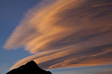 Lenticular Clouds over a Peak at Sunset Photographic Print by Ira Meyer