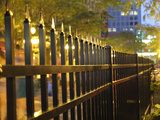 Light Reflects Off a Metal Fence at Night in Downtown Saint Paul, Minnesota Photographic Print by Paul Damien