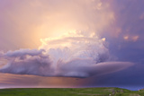Sunset Paints a Decaying Thunderstorm and the Sky a Glowing Purple and Pink Photographic Print by Mike Theiss
