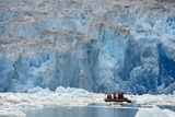 Ecotourists in an Inflatable Raft Observe the South Sawyer Glacier in the Inside Passage Photographic Print by Michael Melford