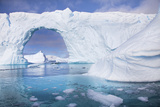 A Huge Arch in an Iceberg Off the Coast of Pleneau Island Photographic Print by Ira Meyer