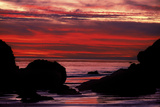 Silhouetted Rock Formations During a Dramatic Fiery Sunset at El Matador Beach Photographic Print by Ira Meyer