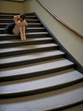 A Ballerina Resting in a Stairwell Photographic Print by Kike Calvo