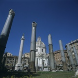 Roman Columns of Trajan's Forum, 100-112 AD, and Church of Most Holy Name of Mary Photo