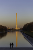 A Couple Standing by the Reflecting Pool in Washington, Dc at Sunset Photographic Print by Jonathan Irish