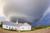 A Rotating Mesocyclone Supercell Thunderstorm Hovering over a Church Photographic Print by Mike Theiss