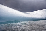 A Smooth Iceberg in Moving Water under Cloudy Skies Photographic Print by Ira Meyer