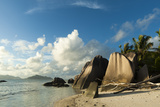 A Sandy Tropical Beach with Large Boulders and a Clear Blue Sky Overhead Photographic Print by Sergio Pitamitz