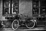 A Bicycle Parked on a Sidewalk Below Two Windows Photographic Print by Jonathan Irish