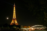 Night View of the Eiffel Tower, the Crescent Moon, and a Nearby Bridge Photographic Print by Babak Tafreshi