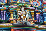 An Intricate Colorful Statue of Shiva at a Hindu Temple Lámina fotográfica por Edwards, Jason