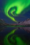 The Aurora Borealis, or Northern Lights, Swirl over a Fjord Fotografisk tryk af Babak Tafreshi