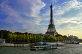 A Scenic View of the Eiffel Tower and a Ferry in the Seine River Photographic Print by Babak Tafreshi