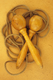 Close Up of Traditional Skipping Rope with Carved and Turned Wooden Handles Lying on Antique Paper Photographic Print by Den Reader