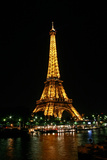 Night View of the Eiffel Tower and Colorful Lights Photographic Print by Babak Tafreshi