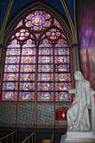A Stained Glass Window and a Statue in Notre Dame Cathedral Photographic Print by Babak Tafreshi