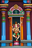 A Colorful Statue of Ganesh Standing Between Pillars on a Temple Wall Photographic Print by Jason Edwards