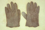 Pair of Pale Brown Cotton Victorian Childs Gloves Lying on Antique Paper Photographic Print by Den Reader