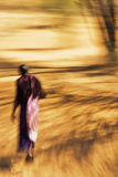 An African Masai Tribesman Walking with Motion Blur Photographic Print by Steven Boone