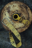 Groundsmans Measuring Tape in Well Worn Metal Case with Brass Winding Handle Lying Photographic Print by Den Reader