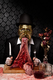 Conceptual Image of Masked Male Figure with Raw Meat on Dining Table Photographic Print by Svante Oldenburg