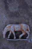 Battered Lead Model of Grazing Horse Lying on Tarnished Metal Photographic Print by Den Reader
